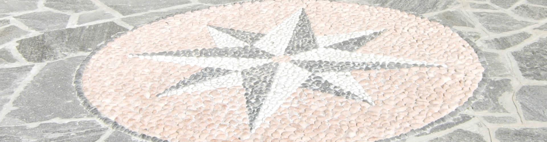 disegni e mosaici realizzati in porfido e pietre naturali